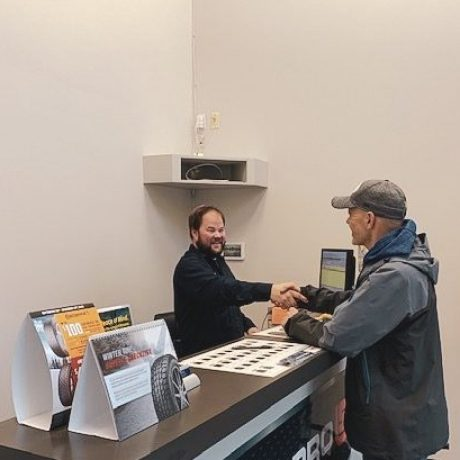 Owner of 1st Street Garage greeting a customer